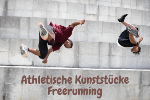 Zwei Männer springen von einer hohen Treppe und machen Saltos - Parkour und Sprünge vom Feinsten